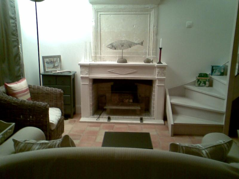 The fireplace and smaller of the two sitting areas