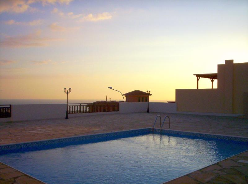 Watch the sunset over the pool