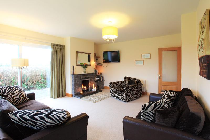 spacious comfortable lounge with real open fireplace + views oveer the West and South
