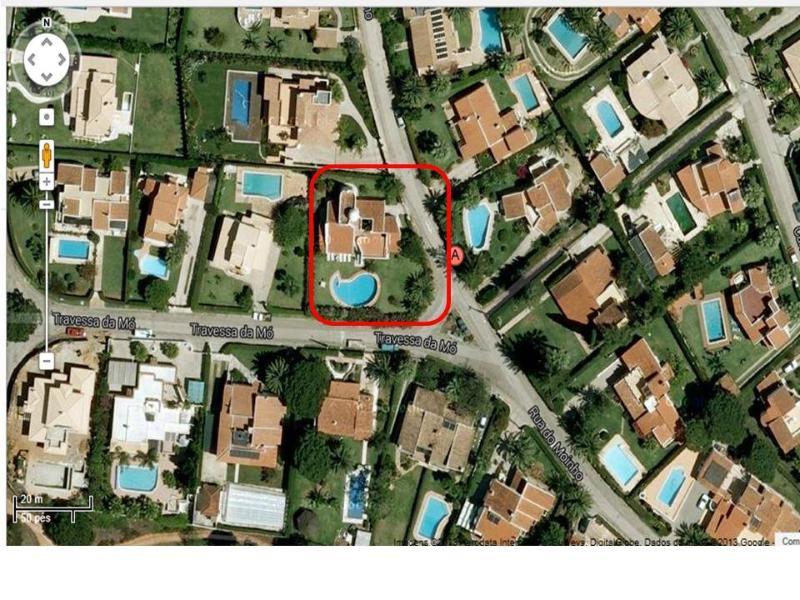 Air view of neighborhood and villa location