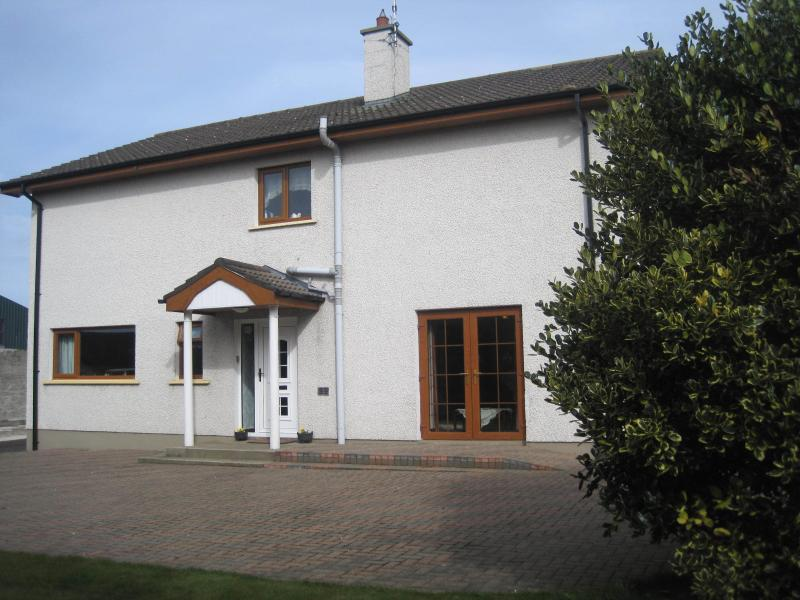 West wing of Farmhouse showing  entrance to  Knockavallen Lodge. Cars can be safely parked on patio.