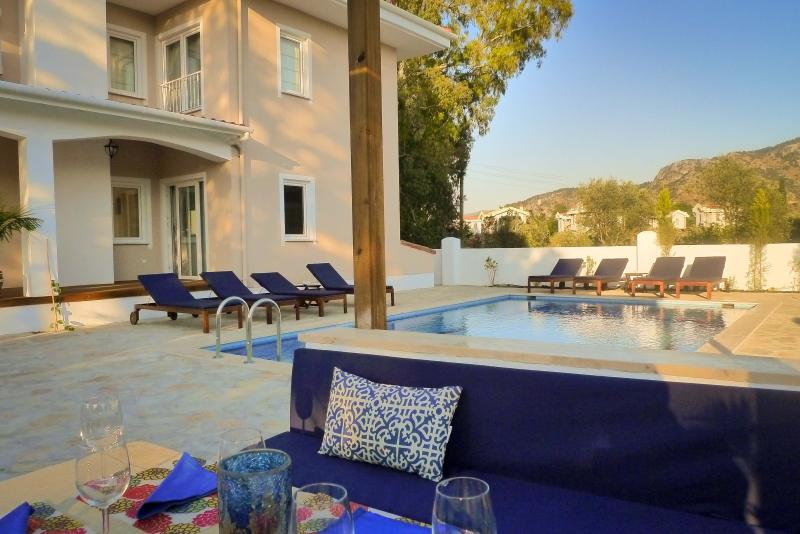 Relax or dine by the pool