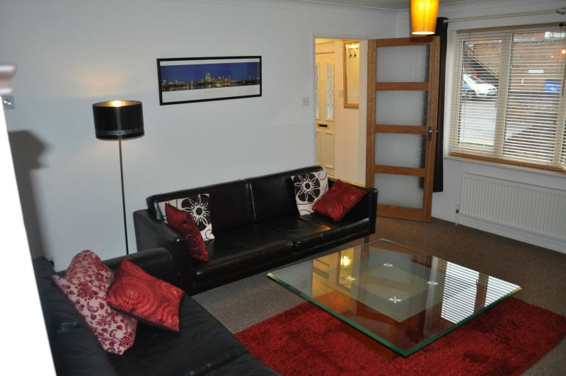 Lounge with 2 x leather sofa's & coffee table. Freeview television with built in DVD.