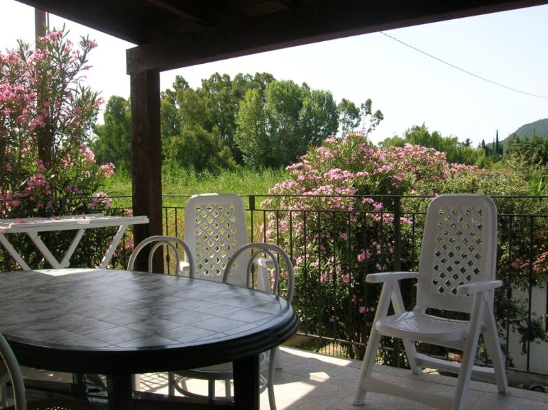 Covered terrance with table and chairs ideal for dining. Small apt.