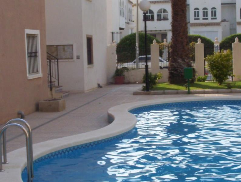 Most enjoyable, beautiful  & well maintained Spanish Beach Apt, pool, gardens in excellent location