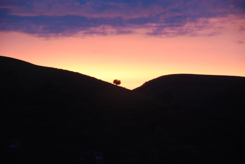 The sun setting beautifully to silhouette Burway Hill