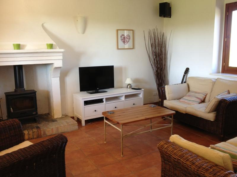 Lounge with 2 sofas, stereo, 32' TV & DVD player