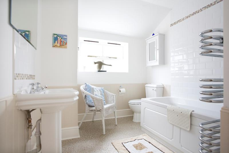 Traditional, bright family bathroom with shower over bath