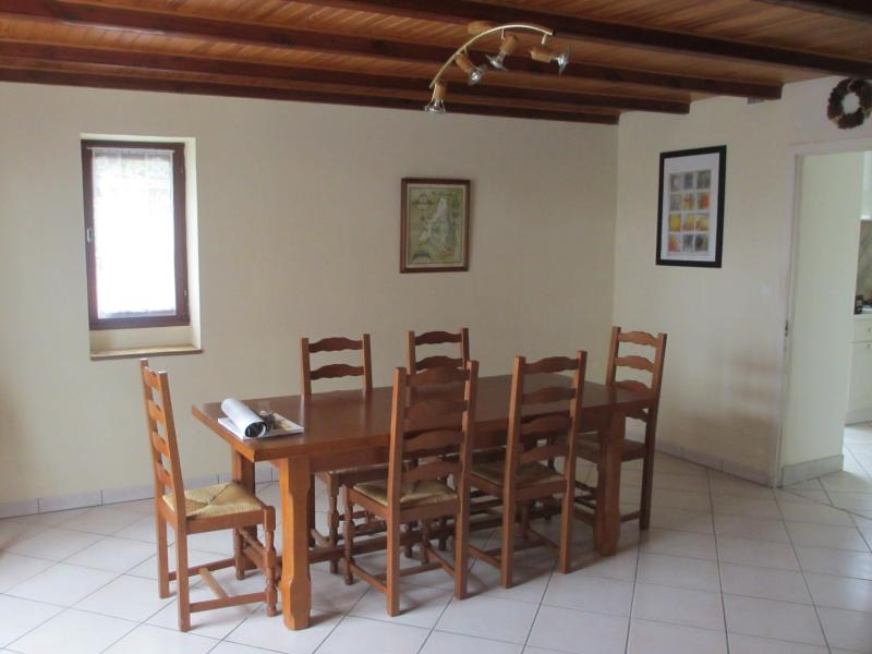 Dining room with solid oak table which seats 8 or more comfortably
