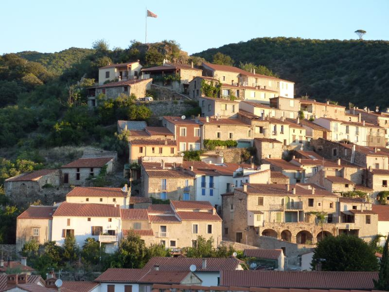Catalan village of Ria-Sirach rising from the lush Conflent Valley