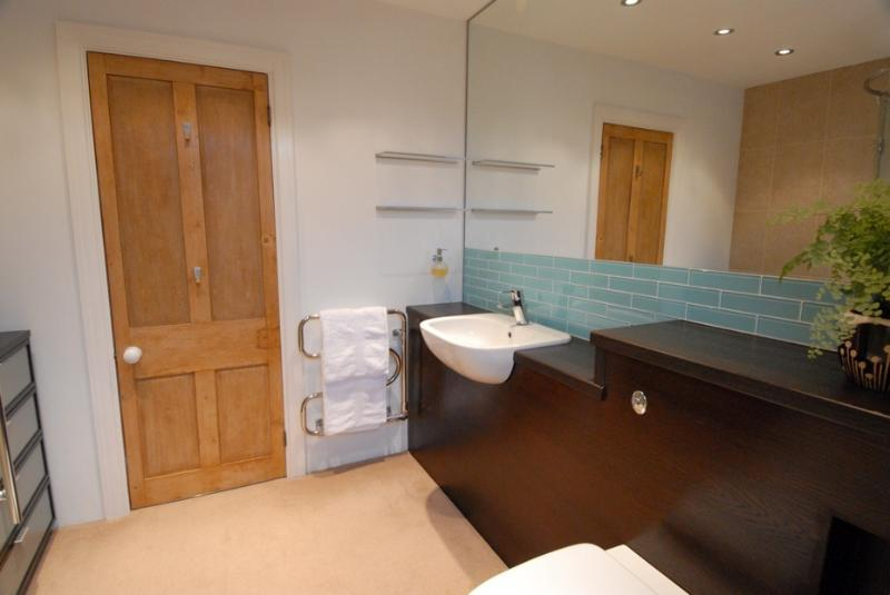 Modern en-suite with wonderful double shower and wall hung toilet