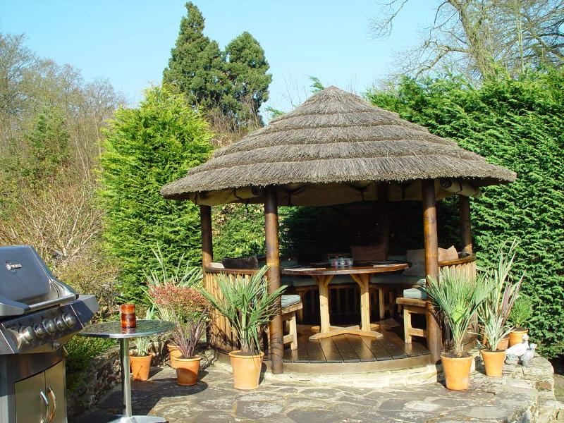 The breeze house in our garden - a shady sittting area, can seat upto ten people