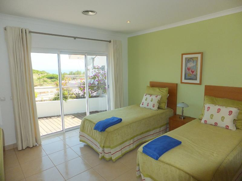 Bedroom 2 with ensuite, first floor with ocean views and leading to balcony