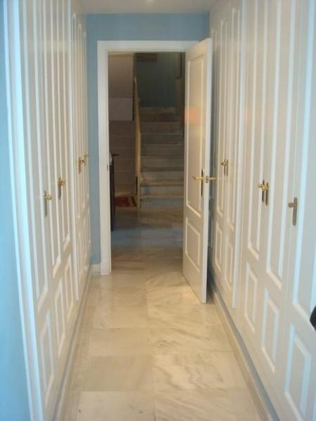 Entrance to main en-suite bedroom with TV