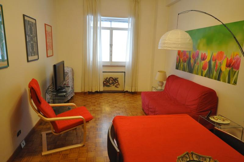 Living room with sofa-bed for 2 more persons, reading chair, TV and DVD player.