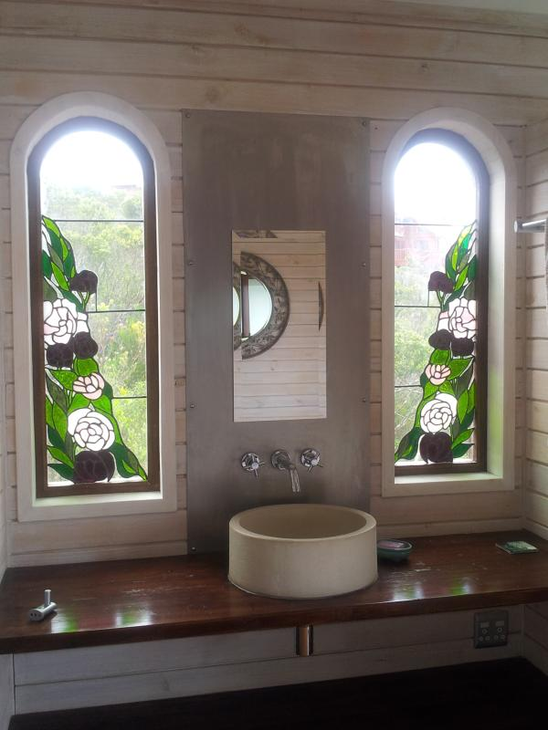 Beautiful stain glass windows enhance both downstairs bedrooms.