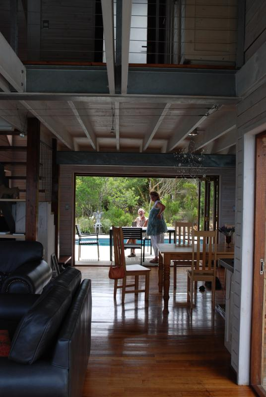 looking through lounge, dining and kitchen area to pool on deck