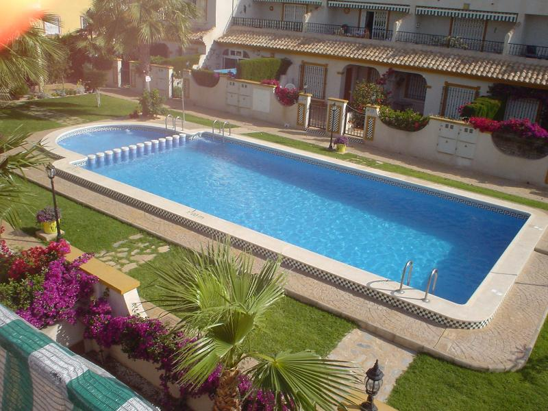 View of pool from upstairs solarium