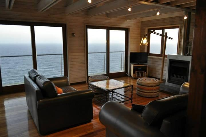 Lounge area with access to ocean deck