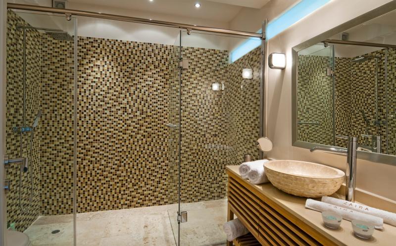 Another en-suite bathroom with luxurious amenities