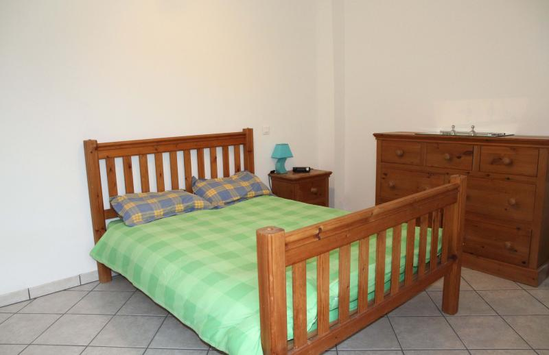 Spacious downstairs bedroom with double bed, chest of drawers and wardrobe