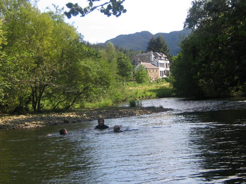 Swimming in river at rear of cabin with Ben Ledi in background