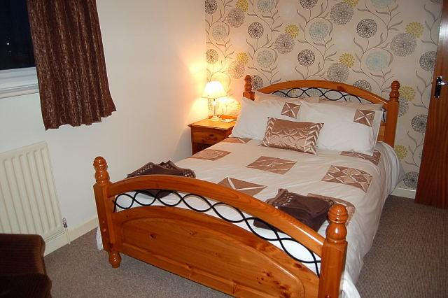 Double room with lovely décor and bedding