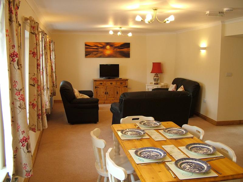 Long Living & Dining room with lots of lovely windows with views of Dartmoor