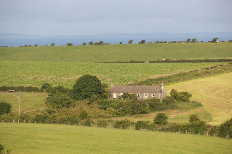 Set in rolling countryside, that's the sea just behind the hill