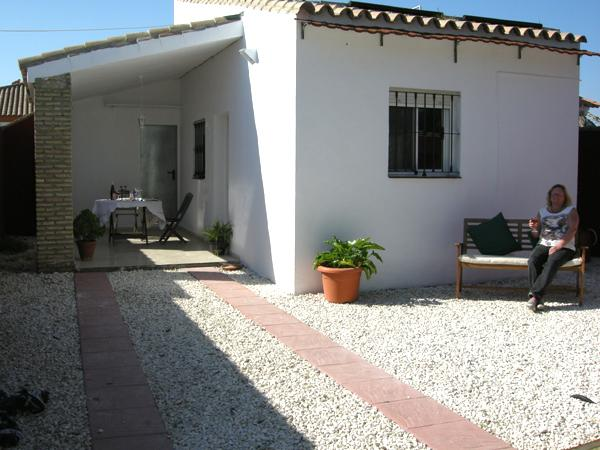Front of the villa beautiful sun trap and garden to have your BBQ and chillax