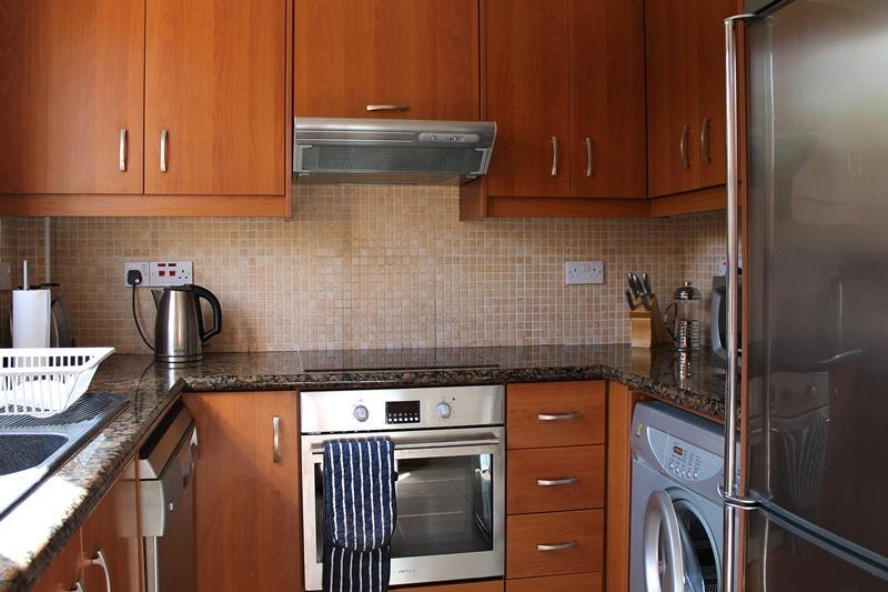 Fully Equipped Modern Kitchen with Dishwasher and Washing Machine