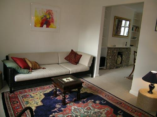 Elegant sitting room with original art work and Persian carpet