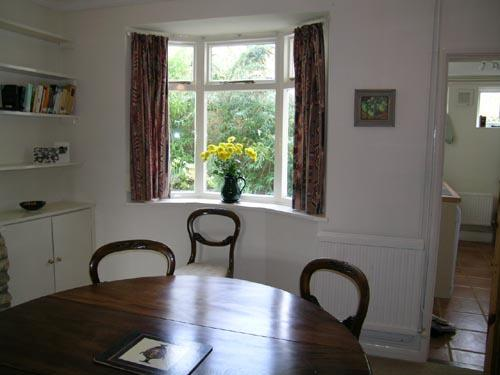 Cosy dining room furnished with high quality antiques