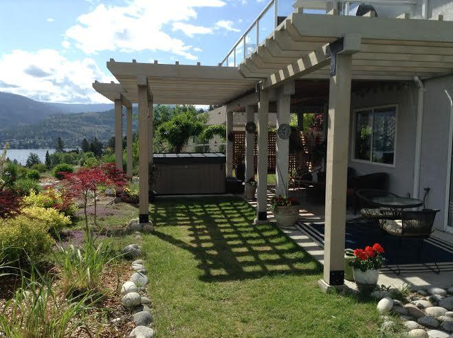 Enjoy the lake and mountain view with a private patio, hot tub and shade.