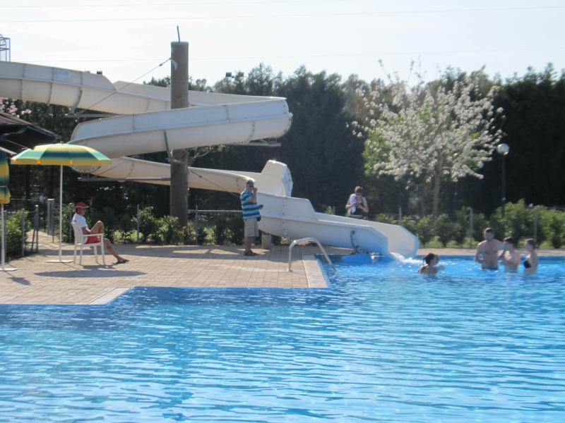 Fun for all the family on the water slide and large swimming pool