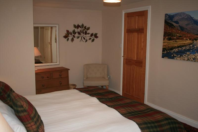 The master bedroom with Super Kingsize bed, fitted wardrobe and ample storage.