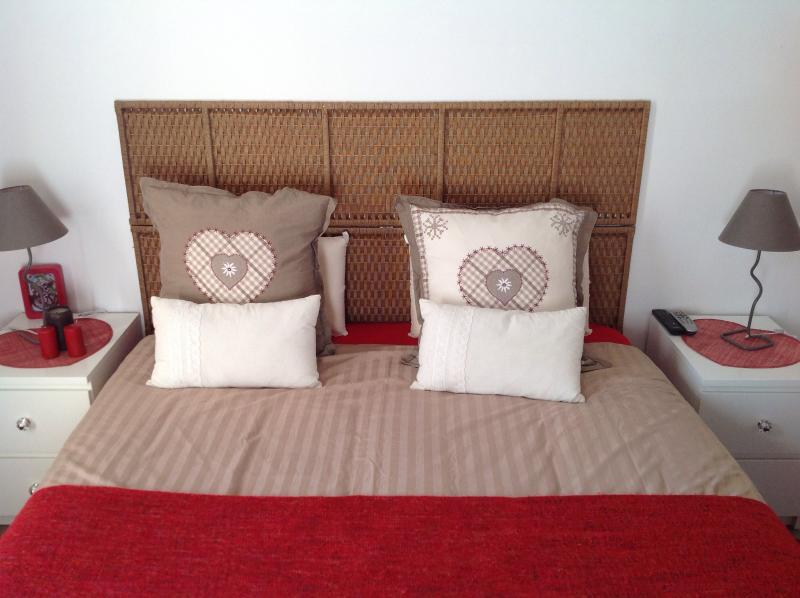 Queen size bed with new mattress in the Main bedroom