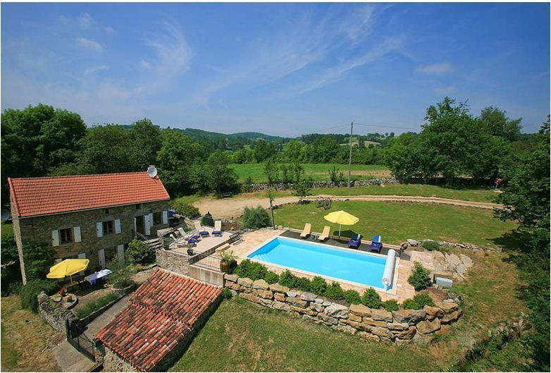 Overview of house and heated pool