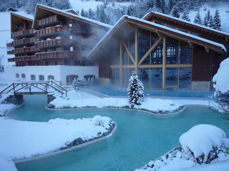 Natural hot mineral spring filled Lazy river with Spa centre behind & apartment on left