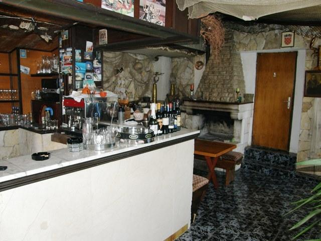 Marble topped bar and indoor fireplace for warming up in long winter nights