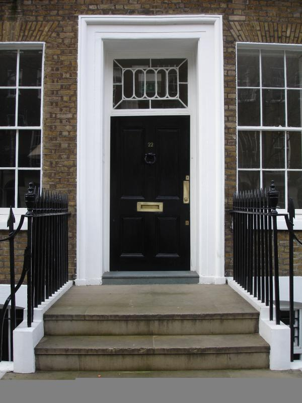 Door to building. Built in the 1740s, we have retained many of the building's original features.