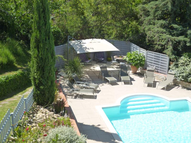 Large heated swimming pool with plenty of shade