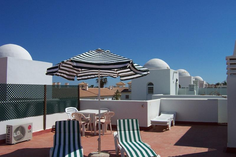 Private roof solarium, it has 4 sunbeds with a table and 4 chairs