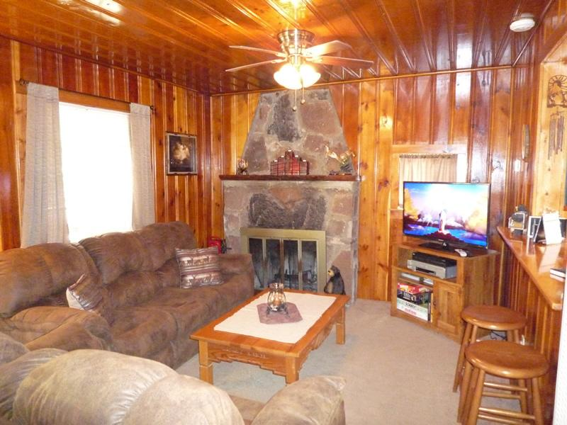 living area large fireplace, queen sleeper sofa and 40 inch tv & dvd