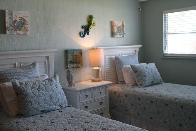 Twin Bedroom on the 'A' side. Calm colors and fun artwork. Treasure chest with toys, too.