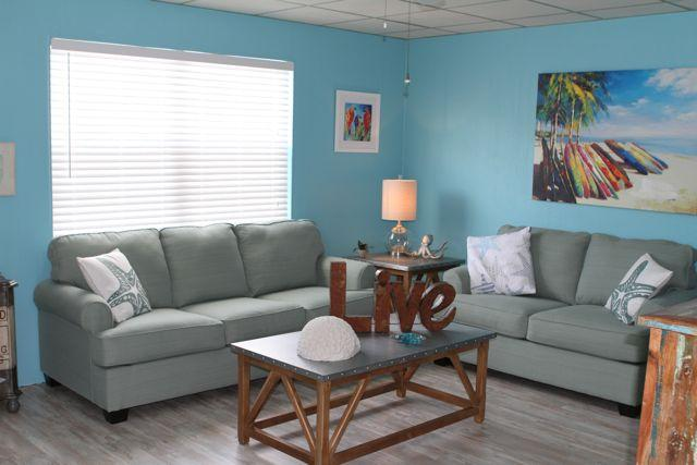 The beautiful 'B' side living room with its' galvanized accent tables and art pieces. Queen sleeper.