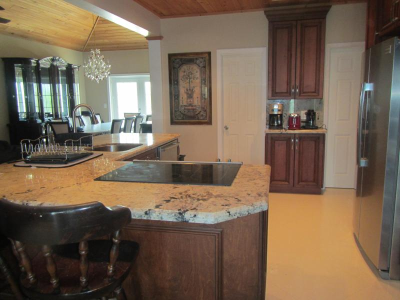 Gourmet kitchen with stainless steel appliances, coffee bar, granite counter tops and marble floors. Serve your family and friends on an elegant Italian 10 chairs dining room set.