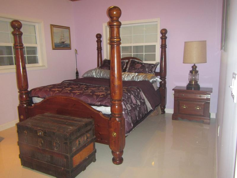Master Bedroom with Queen Bed and private bathroom.