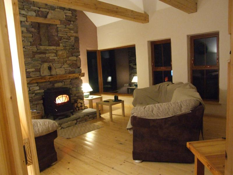 Large sitting room with multi fuel stove and views of Clew Bay.