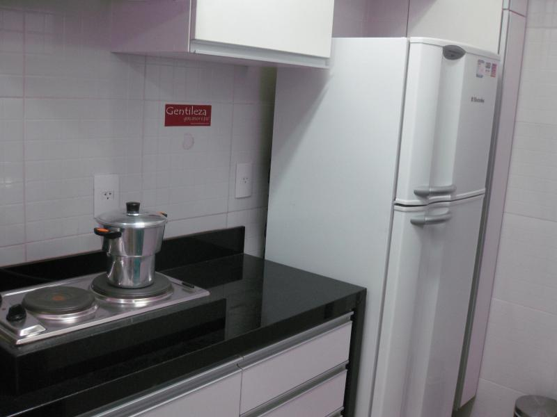 Kitchen with Microwave, Refrigerator, electrical stove, kettle